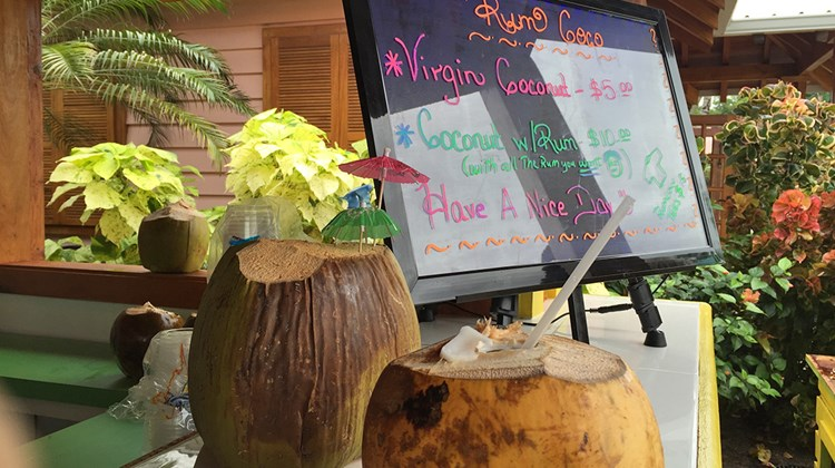 Cold coconut refreshers are for sale in the shopping village at Harvest Caye.