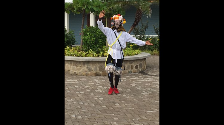 A costumed dancer from the mainland in Belize is part of the entertainment at Harvest Caye.