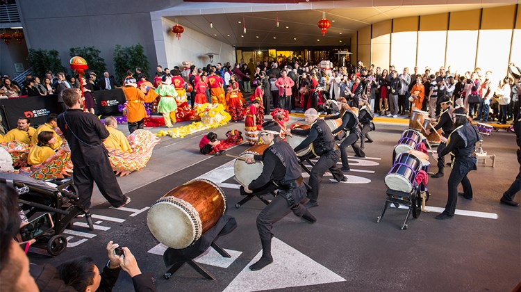 Taiko drummers call the grand opening celebration to commence.