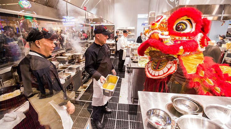 A lion enters the Jewel Kitchen at Lucky Dragon, bringing prosperity and good luck.