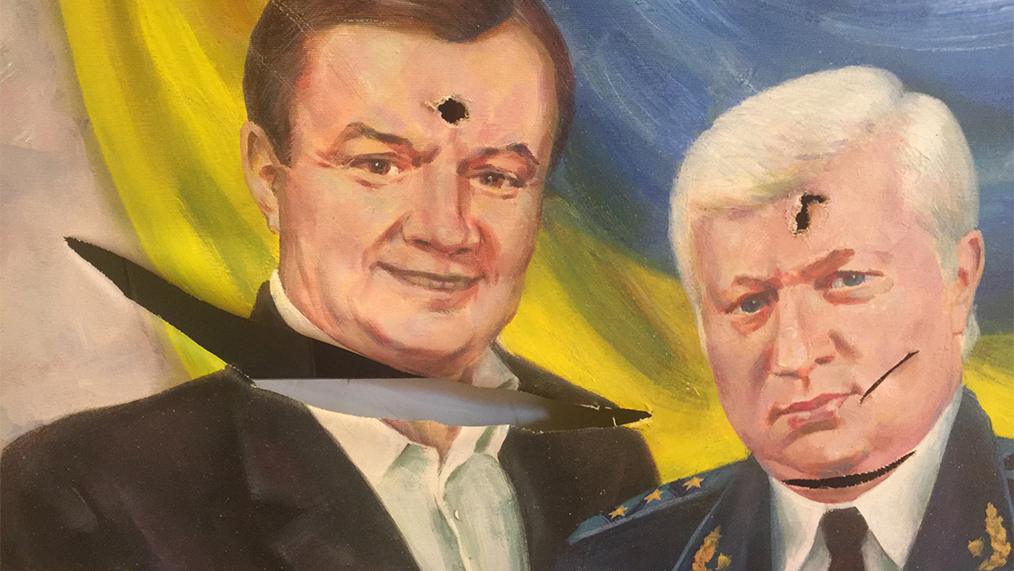 Petro Oliynyk brought this vandalized painting of Yanukovych and Viktor Pshonka, former prosecutor general of Ukraine, from Pshonka's residence. Photo Credit: Arnie Weissmann
