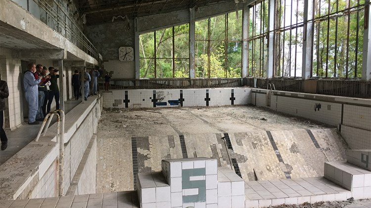 A swimming pool in Pripyat&#39;s main recreational center. According to a tour guide, the glass was removed in order to recycle the metal window frames.<br /><br /><strong>Photo Credit: Arnie Weissmann</strong>