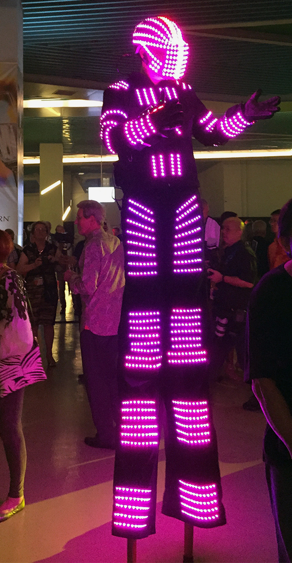 An illuminated stilt walker was part of the pre-event entertainment at the Seabourn Encore christening. Photo Credit: Tom Stieghorst
