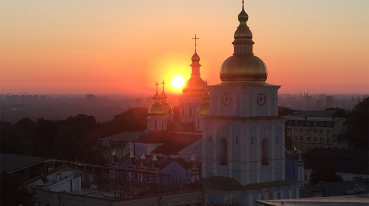 The sun rises over St. Stephen&#39;s Cathedral, in a photo taken from a room at the InterContinental Kiev.<br /><br /><strong>Photo Credit: Arnie Weissmann</strong>