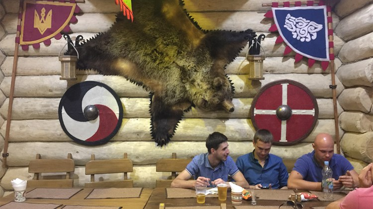 A restaurant in Kievan Rus Park, which attempts to recreate the early history of the country. It&#39;s decorated in a style inspired by medieval Kiev (the cellphone in the hand of one of the diners not withstanding).<br /><br /><strong>Photo Credit: Arnie Weissmann</strong>