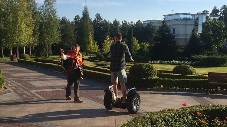 Outside the mansion, Oliynyk gives directions to a visitor navigating the 500 acres of Mezhyhirya on a Segway.<br /><br /><strong>Photo Credit: Arnie Weissmann</strong>