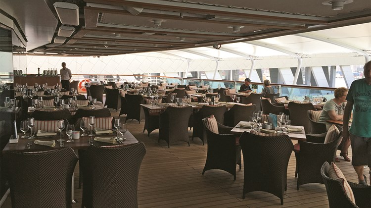 The outdoor patio for the Colonnade restaurant on Seabourn Encore is larger than on previous ships.