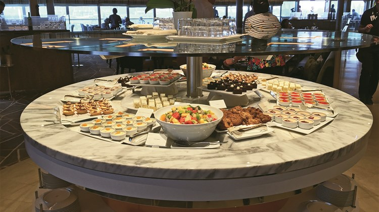 The serving stations in the Colonnade adopt the circular theme prevalent on the Seabourn Encore.