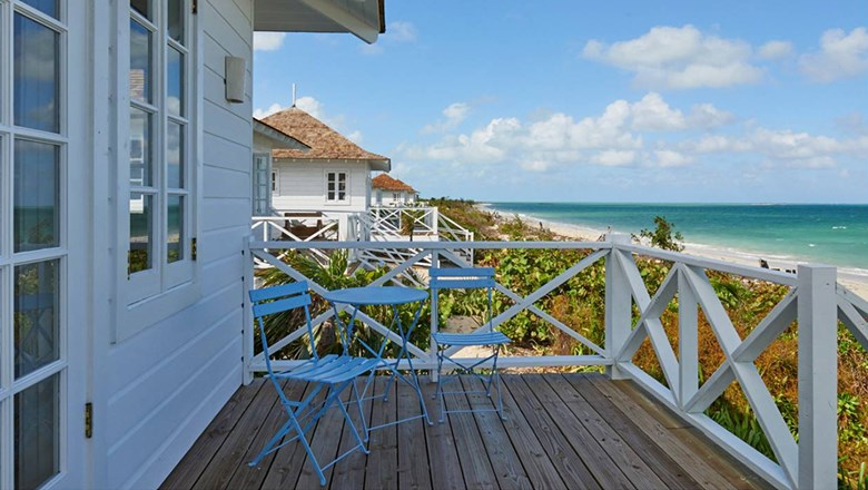 The bungalows offer 16-foot ceilings, private verandahs overlooking the beach.