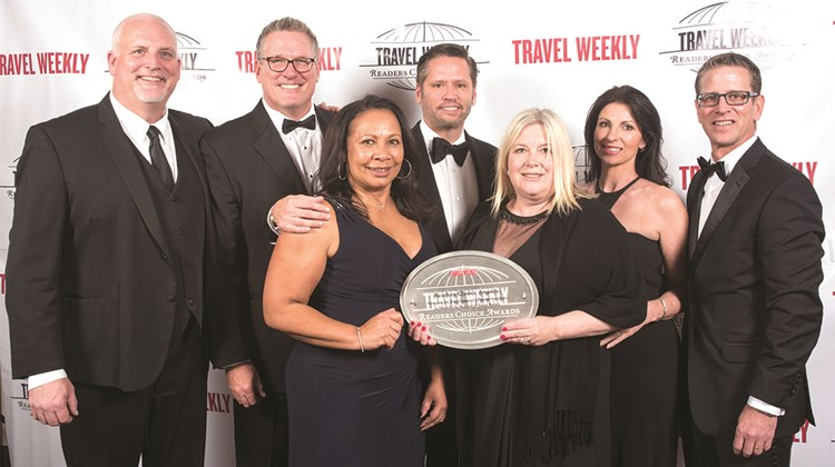 Justin French,  Mike Julius, Ann Hall, Adolfo Perez, Janet Wygert, Erin Martin and Kirk Neal of Carnival Cruise Line.