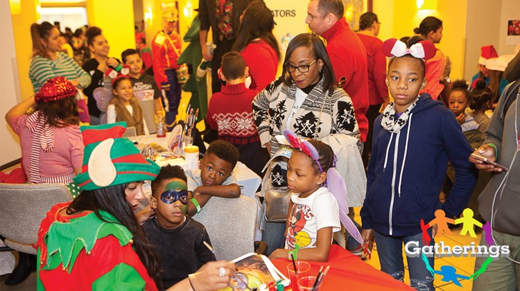 Volunteer Angelica Rivera, left, donned an elf's outfit and a paintbrush during Protravel International's annual Children's Holiday Party at New York's Mount Sinai Downtown hospital. The party, held in conjunction with the Children's Brain Tumor Foundation, invited young patients, their families and caregivers to enjoy activities such as a magic show, a bounce house, live music and a visit from Santa. Each of the 400 kids who attended also received a gift.