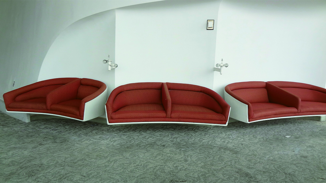 Custom-designed Charles Eames furniture in the former first-class lounge of the TWA Flight Center. Photo Credit: Johanna Jainchill