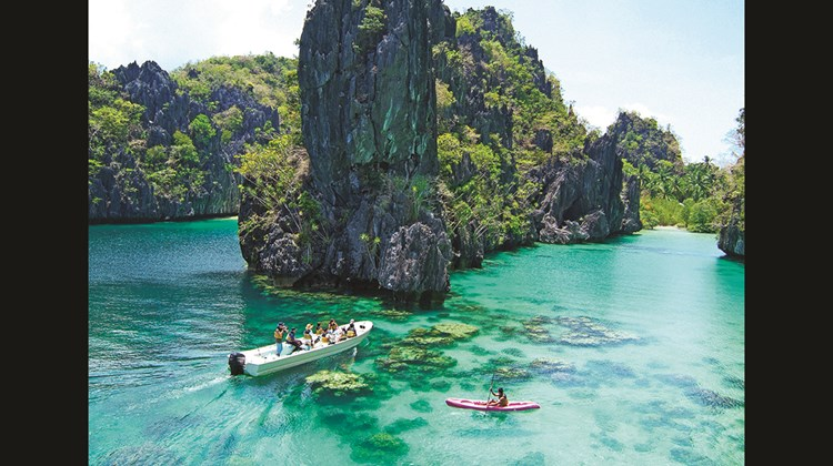 Kayaking in the lagoon near the three El Nido Resorts properties on Palawan.