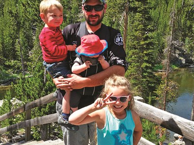 Daniel Lakey and his kids on a Yellowstone vacation. His sister, Lesley Egbert, owner of the Live Longitude agency in Montana, helped plan the family trip.