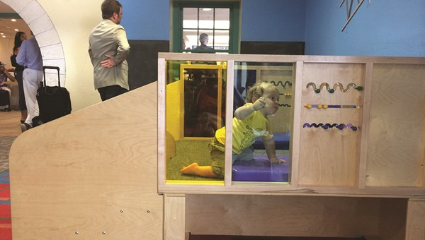 Play spaces at airports, such as the one at Bermuda's L.F. Wade, can keep a toddler entertained while waiting.