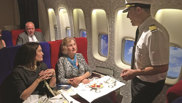 Anthony Toth, co-creator of the Pan Am Experience, talks with passengers Courtenay Taylor, left, and Maureen Taylor, a former Pan Am stewardess, in first class.