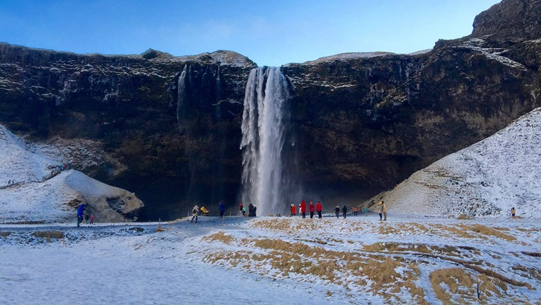 Tourists flock to the Rangarping Eystra waterfall in southern Iceland.