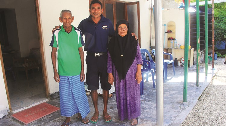 Simo Ali, the watersports manager at Konotta, also doubles as an excursions guide; he poses with his parents at their home on Fiyoaree, the first stop on his tours.<br /><br /><strong>Photo Credit: Arnie Weissmann</strong>