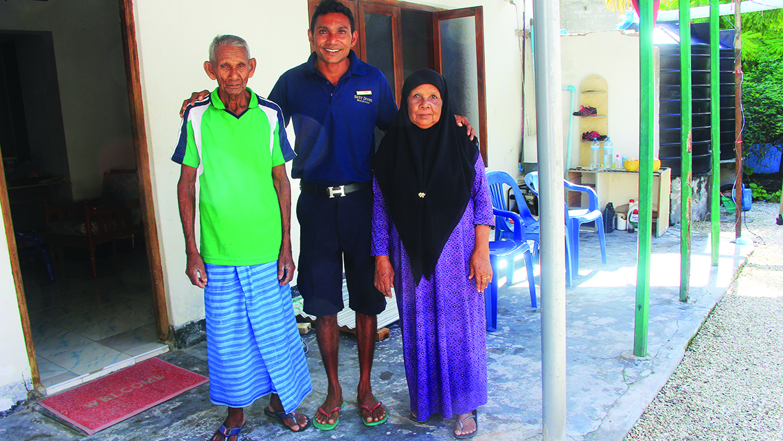 Simo Ali, the watersports manager at Konotta, also doubles as an excursions guide; he poses with his parents at their home on Fiyoaree, the first stop on his tours. Photo Credit: Arnie Weissmann