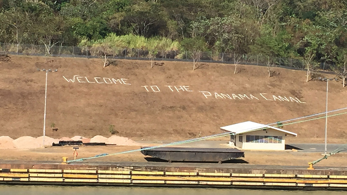 A sign on the banks of the Panama Canal near the Centennial Bridge at the approach to the Pedro Miguel locks. Photo Credit: Tom Stieghorst