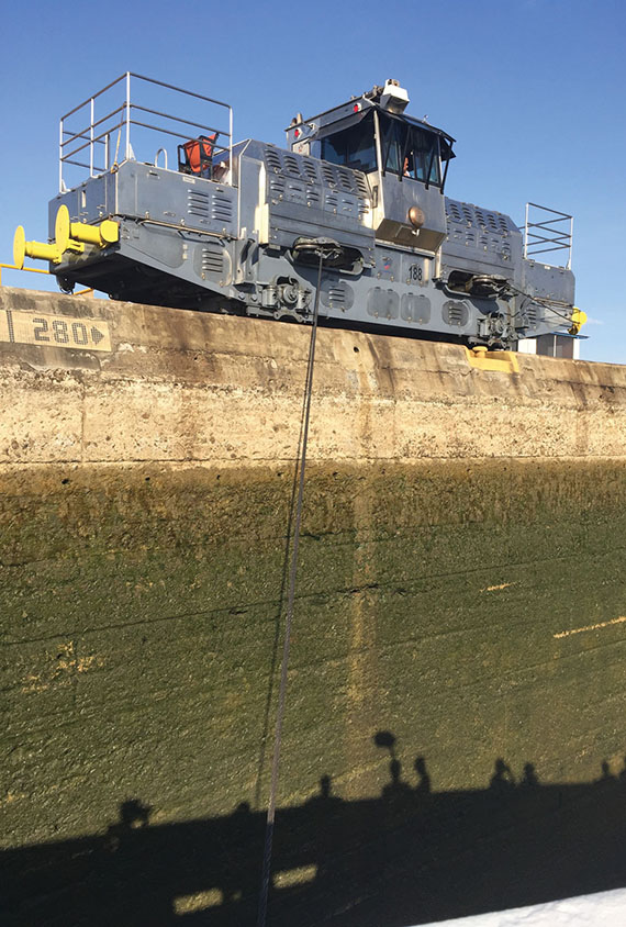 "An electric locomotive ""mule"" attached to the Star Pride to pull it through one of the locks in the canal and minimize the chances for accidents. Photo Credit: Tom Stieghorst"
