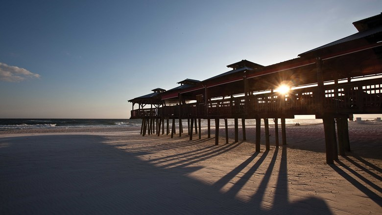 A pier at sunset on Panama City Beach.