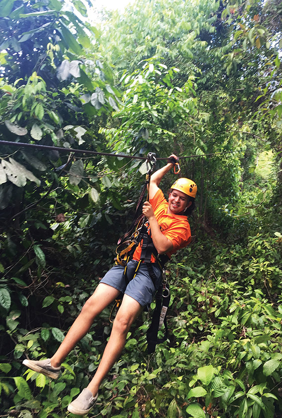 A guide ziplines through the canopy of the rain forest in Corcovado National Park.