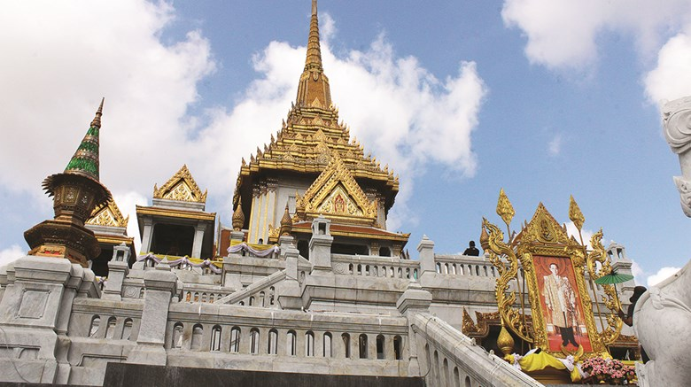 At the invitation of the Tourism Authority of Thailand, destinations editor Eric Moya recently visited Bangkok and Trat province to experience off-the-beaten-path destinations and activities. Pictured here, the Temple of the Golden Buddha. Memorials to King Bhumibol, who died in October, can be seen throughout the country.