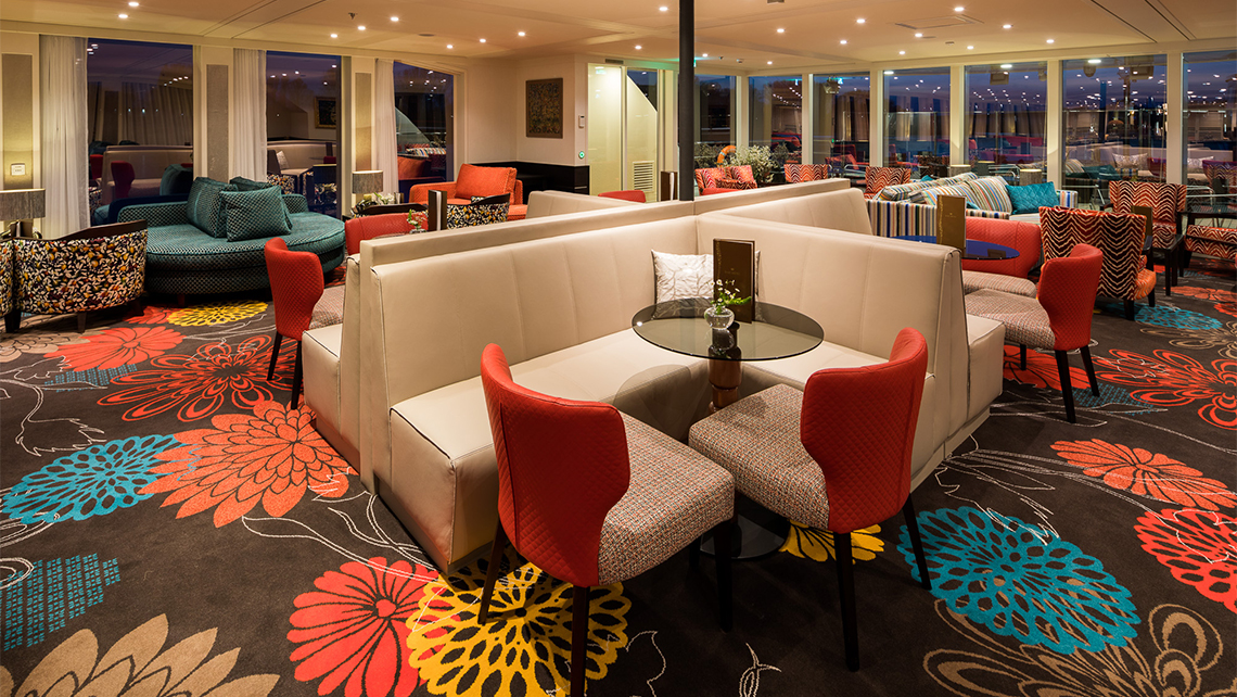 AmaWaterways incorporated a warm and vibrant color palette in the lounge.