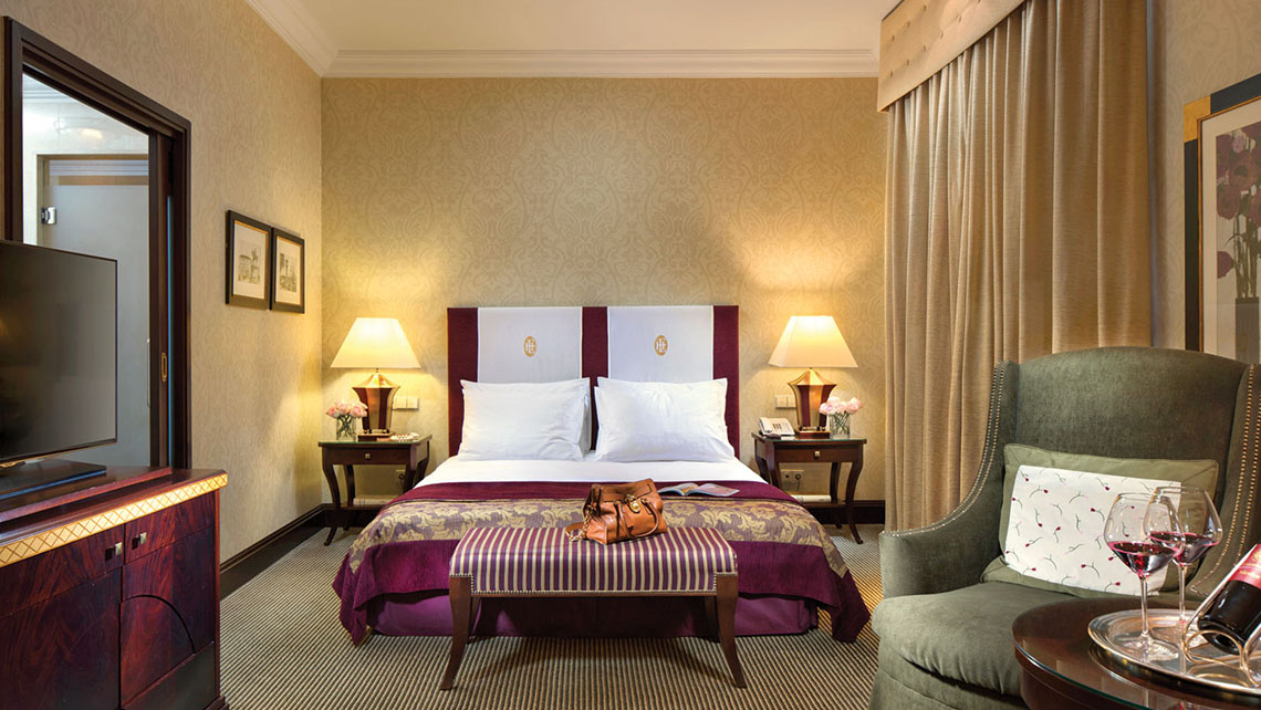 The Superior room in the Esplanade Zagreb Hotel features goose-down duvets and classic luxury standards such as dark wood and thick carpets.