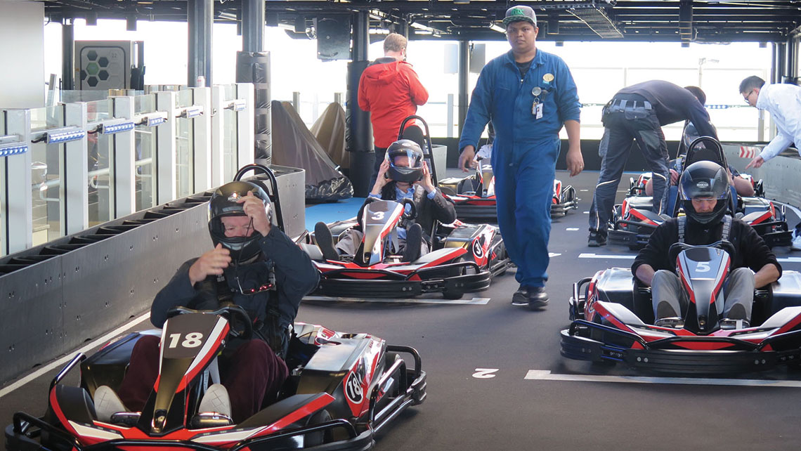 Competitors in the pit area prepare for a race. Guests in the Haven and Concierge premium accommodations will get complimentary use of the track. Photo Credit: Anne Kalosh