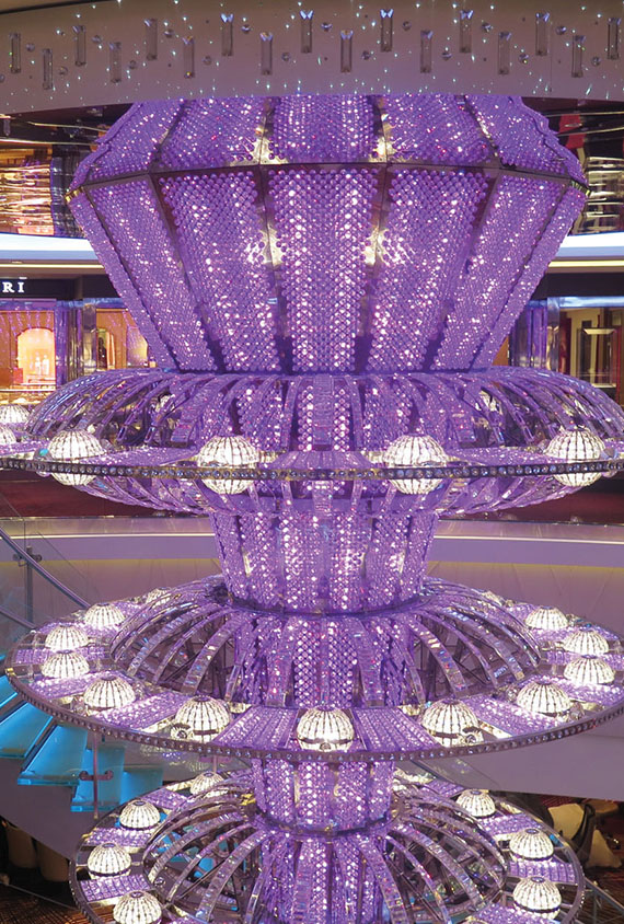 The atrium of the Norwegian Joy features a color-changing, cascading chandelier.