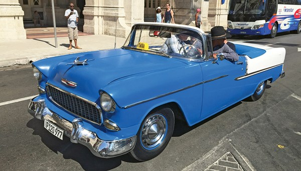 A vintage car is one of the sights that differentiate a trip to Havana.