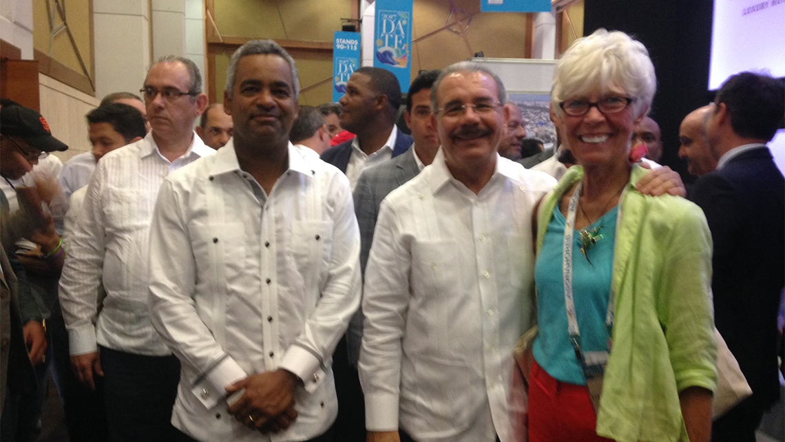 On the trade show floor, Caribbean editor Gay Nagle Myers met with the president of the Dominican Republic Danillo Medina, center, and joel Santos Echavarria, president of the Hotels & Tourism Association of the Dominican Republic.