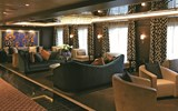 A lounge on Regent Seven Seas' Seven Seas Explorer. Norwegian Cruise Line Holdings CEO Frank Del Rio showed the designers a photo of a hotel corridor with a chandelier that embodied the luxurious feel he wanted for the Explorer.