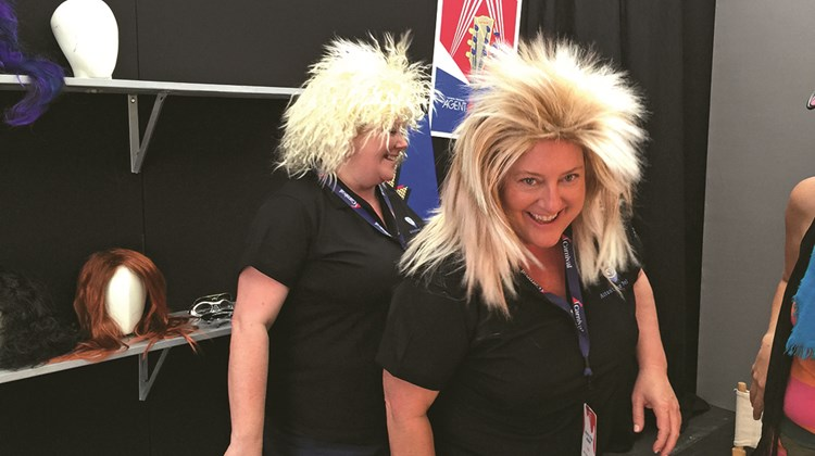 Tracey Broussard and Cheryl Tolbert, co-owners of Attentive Travel, Baton Rouge, La., try on rock star wigs.<br /><br /><strong>Photo Credit: TW photo by Tom Stieghorst</strong>