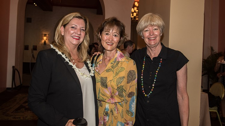 From left, Cheryl Williams, general manager of the host hotel, the Royal Hawaiian, with Amy Terada of Pleasant Holidays and Debbie Anderson, CEO of Destination Marketing Hawaii, which represents Travel Weekly on the Islands.