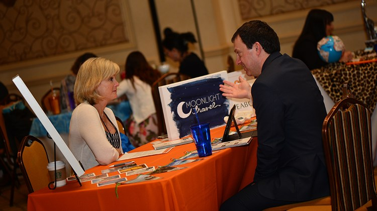 Marco Franco of Visitflanders meets with Jill Smith of Moonlight Travel during a 6-minute, one-on-one appointment.<br /><br /><strong>Photo Credit: Jim Harris</strong>