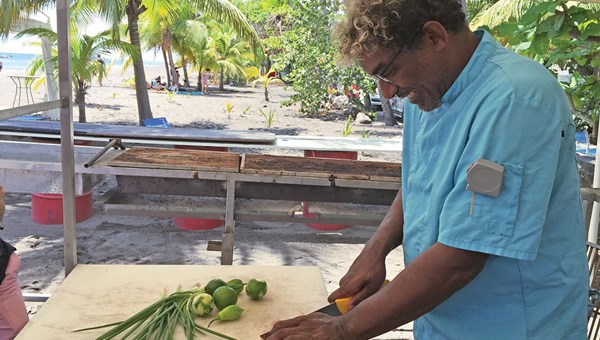 Chef Guy Ferdinand makes a ceviche from fresh marlin, scallions, lime and pepper at his beachfront restaurant, Le Petibonum.