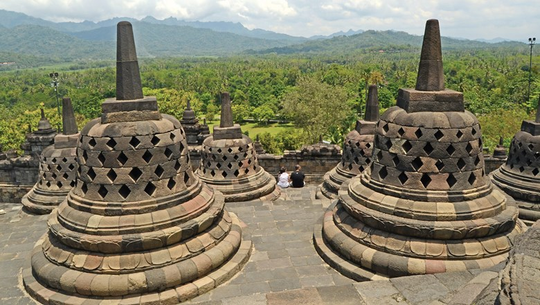 The stupas of the Borobudur temple compound on Java. It is the largest Buddhist monument in the world and contains 72 statues of Buddha.