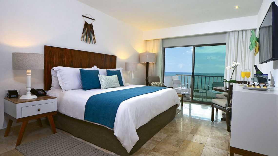 A Deluxe Room with a king bed. All of the redone rooms face the ocean and include a terrace and smart TVs.