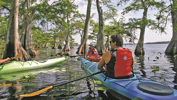 Visit Florida avoided having its budget slashed by the state legislature after a record 112 million travelers came to the Sunshine State in 2016, visiting sites such as Miami and taking part in activities like kayaking on Lake Norris (pictured).