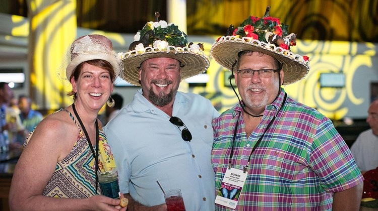 Rachelle Debaun of Peace Frogs Travel/Outfitters, Mark Bennigan of Dreamers Travel and Richard Stiff of Cruise Planners enjoy a Kentucky Derby-themed Welcome Reception sponsored by the Greater Fort Lauderdale Convention and Visitors Bureau.
