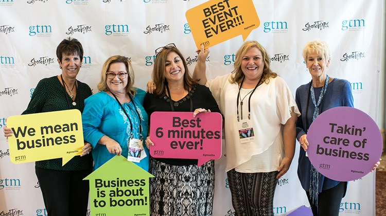 GTM attendees have some social media fun at the Step & Repeat sponsored by ShoreTrips.