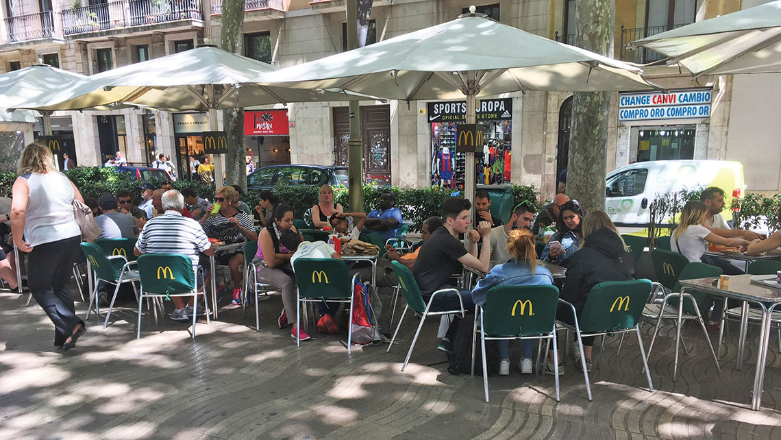 A McDonald's restaurant on Las Ramblas, the tree-lined pedestrian mall where many cruisers and beachgoers enter the city. Photo Credit: William Nash