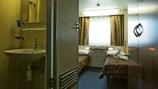 A twin cabin aboard the Dnieper Princess, with its combined shower/sink.