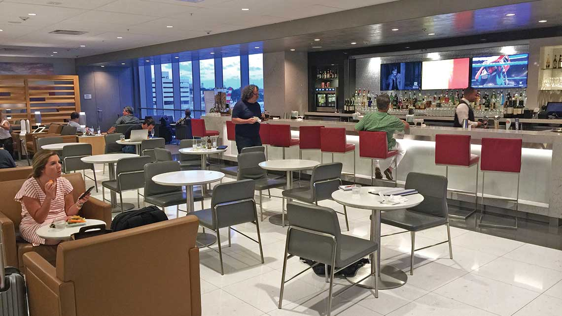 The upgraded bar and dining area at the newly remodeled Admirals Club at Miami Airport.