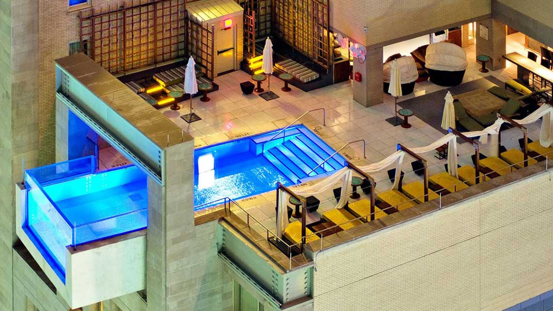 The cantilevered, glass-walled pool at the Hotel Joule in Dallas.