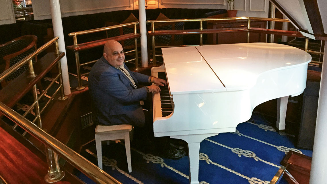 The ship's piano lounge, the center of onboard social life. Photo Credit: TW photo by Tom Stieghorst