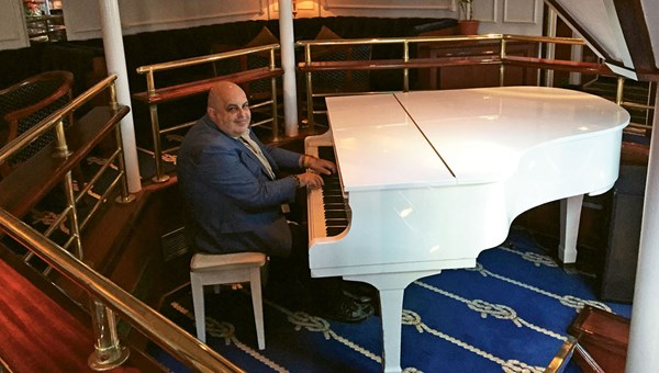 The ship's piano lounge, the center of onboard social life.